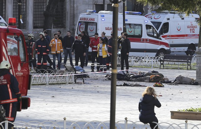 ATTENTION EDITORS - VISUALS COVERAGE OF SCENES OF DEATH OR INJURY Rescue teams gather at the scene after an explosion in central Istanbul, Turkey January 12, 2016. Turkish police sealed off a central Istanbul square in the historic Sultanahmet district on Tuesday after a large explosion, a Reuters witness said, and the Dogan news agency reported several people were injured in the blast. REUTERS/Kemal Aslan      TPX IMAGES OF THE DAY     TEMPLATE OUT.